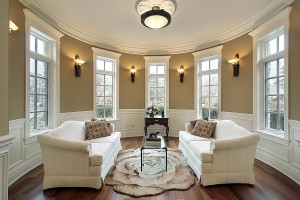 Living room in luxury home with lighting scones